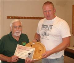 The monthly winner Norman Smithers received his certificate from Tony Handford